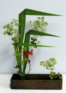Gail's Straight Line and Soft Mass made with crocosmia leaves, a crocosmia flower and ladies mantle.